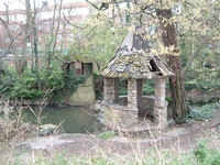 Pepperpot gazebos on the River Brent, left over from the old Brent Bridge Hotel