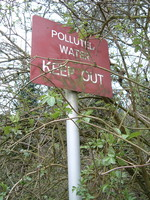 A sign along Mutton Brook that says 'Polluted Water, Keep Out'