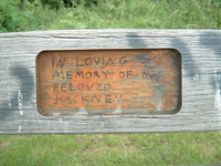 Graffiti on a bench opposite the Lesney Industries factory that says 'In loving memory of my beloved Hackney'