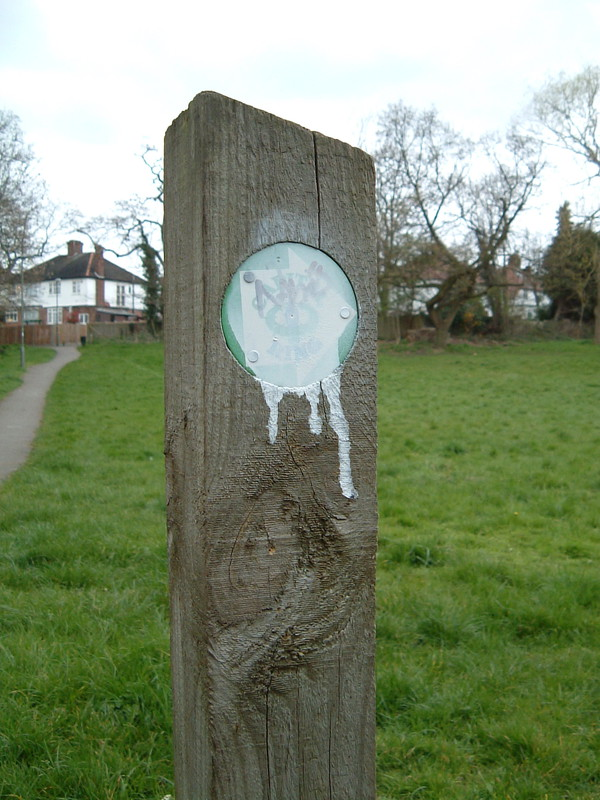 A vandalised Capital Ring signpost where Dollis Brook and Mutton Brook merge to form the River Brent