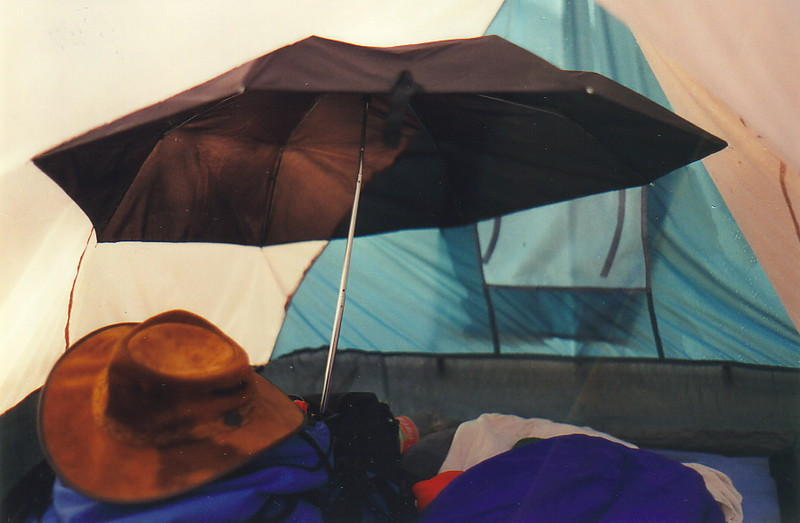 An umbrella inside a tent